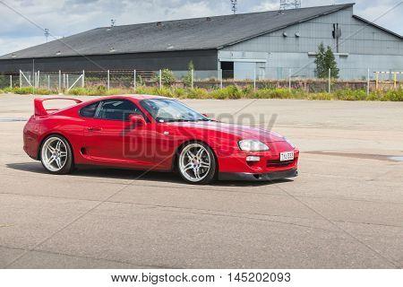 Red Toyota Supra A80