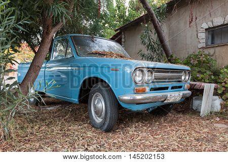 Closeup View Of Old Blue Datsun 1300 Pickup Car