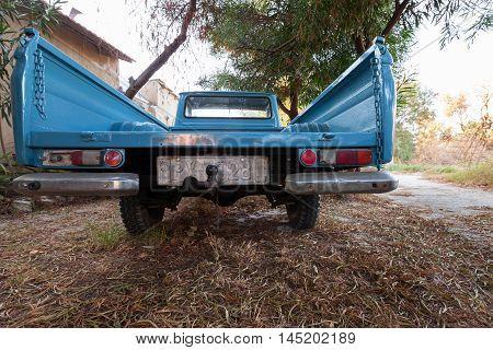 Rear View Of Old Blue Datsun 1300 Pickup Car
