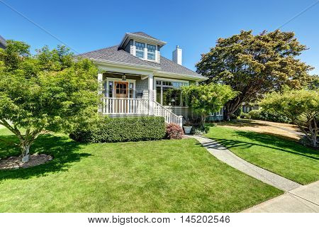 Single-family American craftsman house exterior. Blue sky background and nicely trimmed front yard. Northwest USA poster