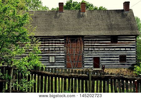 Old Salem North Carolina - April 21 2016: Fachwerk log and stucco barn at the 1769 Single Brothers' House