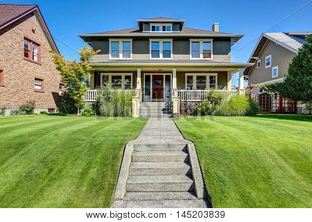 Nice curb appeal of American craftsman style house. Column porch view and well kept lawn in the front. Northwest USA poster