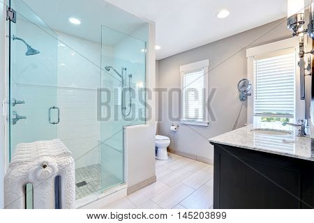 Refreshing Bathroom With Walk In Shower And Cast-iron Radiator