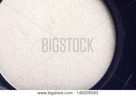 Macro crumbly eyeshadow refill. Professional cosmetic. Make-up tools.