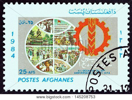 AFGHANISTAN - CIRCA 1985: A stamp printed in Afghanistan issued for the 20th Anniversary of the People's Democratic Party shows Globe and Emblem, circa 1985.