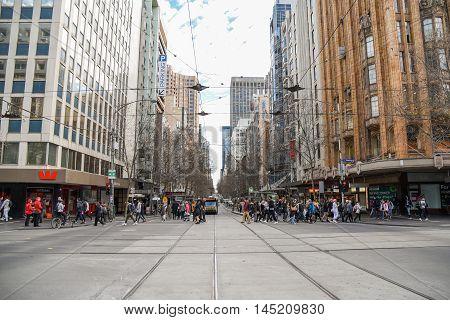 MELBOURNE AUSTRALIA - JULY 18 2016 : Unidentified people walk in Melbourne city Victoria Australia.