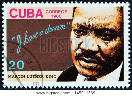 CUBA - CIRCA 1986: A stamp printed in Cuba issued for the 18th death anniversary of Martin Luther King shows human rights campaigner Martin Luther King, circa 1986.