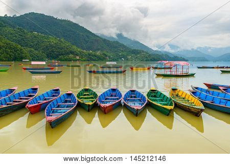 Colorful small boats on Phewa Lake in Pokhara, Nepal