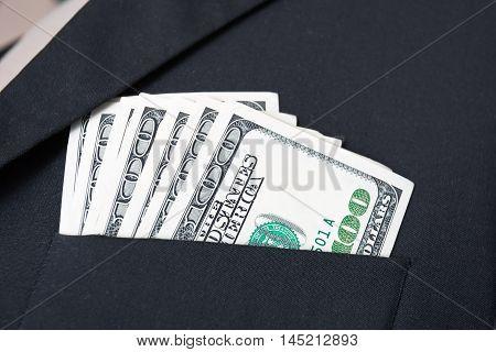 United States dollar (USD) bills - in businessman suit pocket