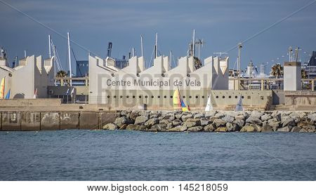BARCELONA SPAIN - JULY 13 2016: The Municipal Sailing Centre is located in Barcelona Port Olimpic next to the beach. Nautical offers various courses - sailing catamaran windsurfing etc.