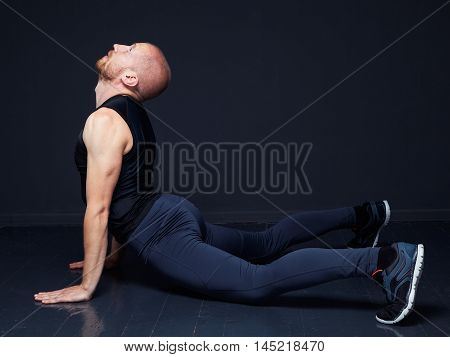 Young Man Doing Stretching Exercise