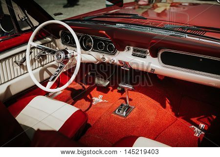 MALAGA, SPAIN - JULY 30, 2016: 1965 Ford Mustang interior view in red color, parked in Malaga aerodrome, Spain.