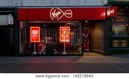 NOTTINGHAM ENGLAND - AUGUST 30: Frontage of the Virgin Media store at night on Clumber Street. In Nottingham England. On 30th August 2016.