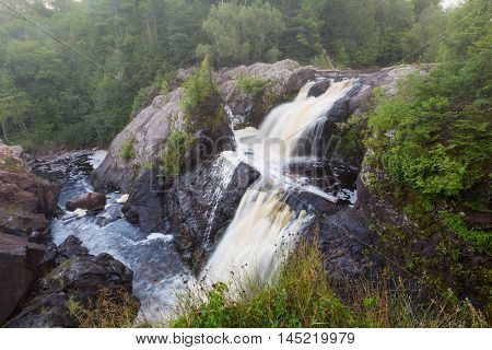 Gabbro Falls in the Upper Peninsula of Michigan - A misty morning at this beautiful waterfall on the Black River.