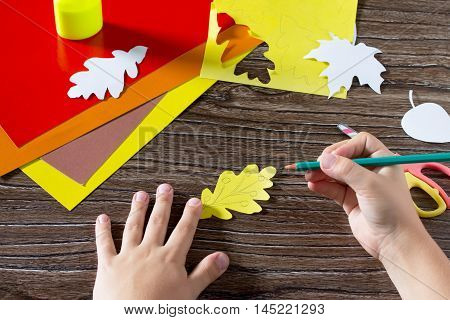 Autumn Colored Paper Leaves On The Wooden Background. The Child Draws Leaves. Sheets Of Paper Crafts