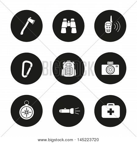 Camping icons set. Axe, binoculars, walkie-talkie, carabiner, backpack, photo camera compass, flashlight and first aid kit. Tourist's equipment. Vector white illustrations in black circles