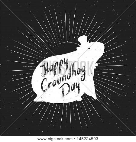 Groundhog Day greeting card. White design on a black background. Hand-written lettering on vintage grunge background. Groundhog Day emblem with the silhouette of a marmot in a retro style.