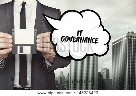 IT Governance text on speech bubble with businessman holding diskette