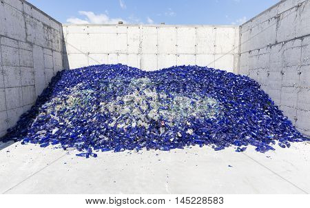 Glass Waste In Recycling Facility. Blue Bottles