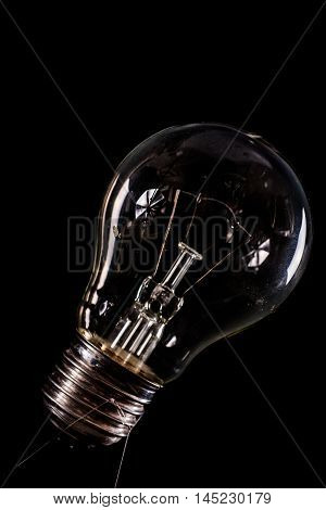 incandescent light bulb off in low key