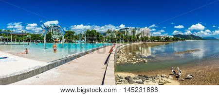 CAIRNS, AUSTRALIA - 27 MARCH 2016. The Esplanade in Cairns with tropical swimming lagoon and the ocean, Queensland, Australia.