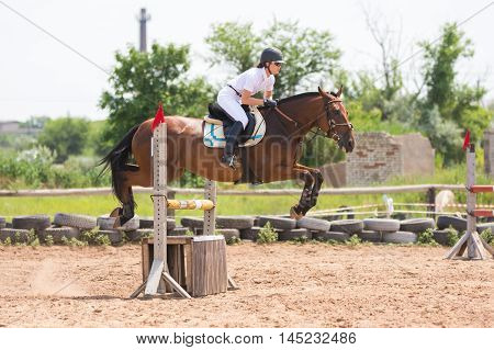 Volgograd, Russia - June 19, 2016: Sportsman On Horse Jumping Over A Hurdle At The Competition In Sh