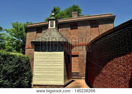 New Bern North Carolina - April 24 2016: Wooden Privy curved colonnade wall and stables wing at 1770 Tryon Palace