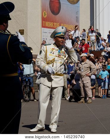MOSCOW, RUSSIA - August 27, 2016: Bandmaster of brass band from Kazakhstan asks the audience what musical composition to execute. Festival of military orchestras