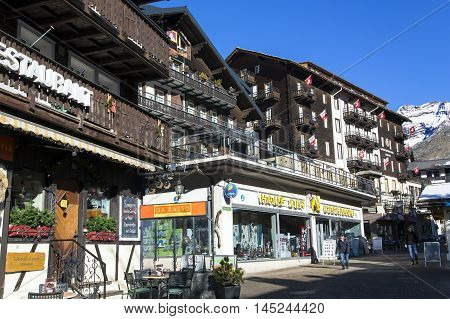SWITZERLAND, SAAS-FEE, DECEMBER, 26, 2015 - Street with restaurants, shops and modern hotels in the charming Swiss resort of Saas-Fee, Switzerland