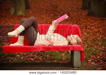 Blonde Lady Lying On Bench.