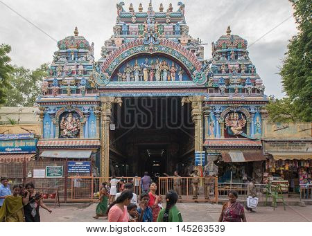 Madurai India - October 19 2013: The entrance facade to the public market hall called Nagara Mandapam. Police and visitors in the photo. Vendor stalls on the side.