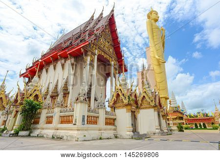 Roiet Thailand - Aug 23 2016 : The Tallest standing Buddha image in Thailand and The Sixth in the world with it's 67.8m tall at Burapapiram Temple