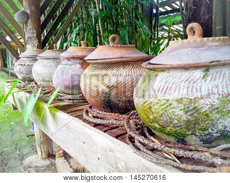 Thailand ancient water clay pottery.  Water pot on the shelf for guests. Thailand culture, water pottery for guests
