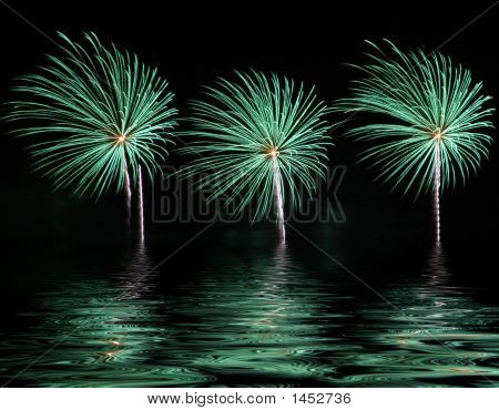 Bright and colorful fireworks display with reflection on water. poster