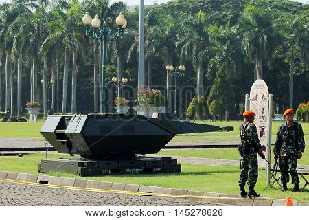 Jakarta, Indonesia - August 17, 2016: Indonesian military air force troops guarding near the mobile anti-aircraft turret weapon during the independence day flag ceremonial that held at Indonesian Presidential Palace.