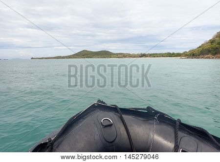 Front of black dinghy boat on the sea