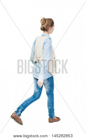 back view of walking  woman. beautiful girl in motion.  backside view of person.  Rear view people collection. Isolated over white background. Girl in a vest is left.