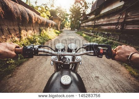 Biker Driving His Motorcycle On Country Road