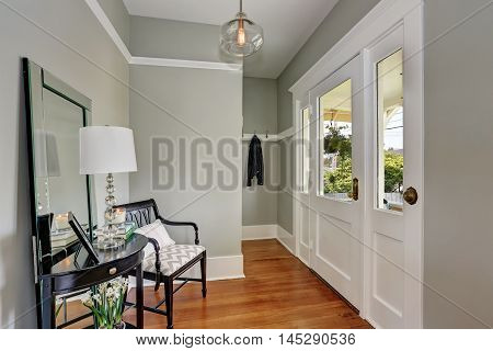 Entryway With Gray Walls, Console Table And Wood Floors