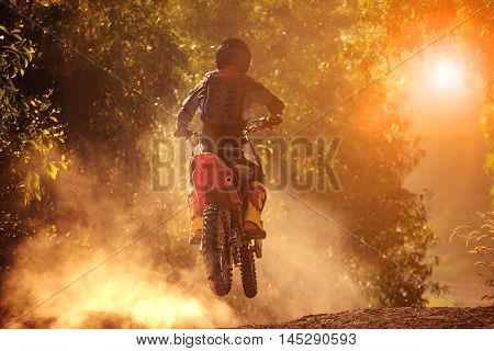man riding motorcycle in motor cross track use for people activities and leisure traveling