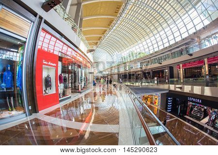 SINGAPORE - JUNE 26 2015 : The Shoppes at Marina Bay Sands is one of Singapore's largest luxury shopping malls with over 800000 square feet of high-end retail shoppes.