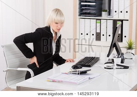Young Businesswoman Suffering From Backache In Office