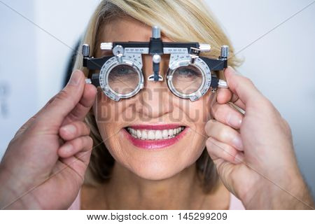 Optometrist examining female patient with messbrille in ophthalmology clinic