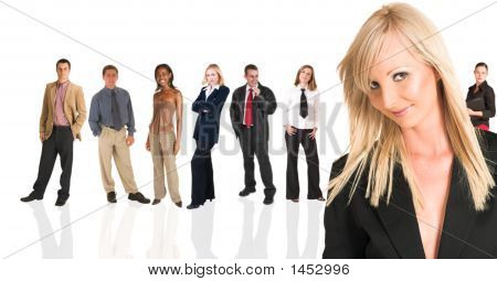 Blonde Businesswoman Standing In Front Of A Business People Group