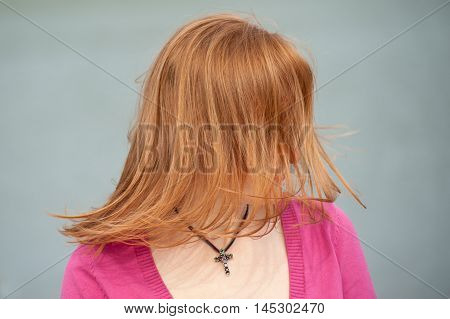 Waving in the wind red hair woman