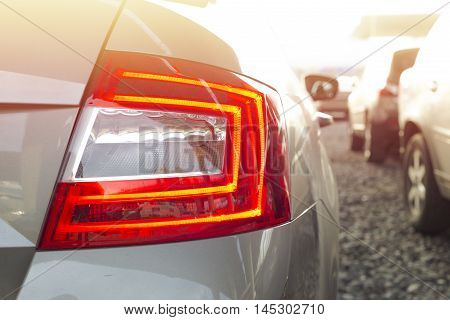 Back lights of a parked car with bright sun light