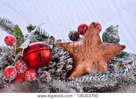 Bronze Star In Fir Tree Branch With Berries
