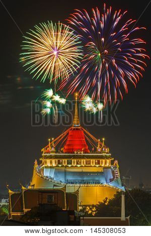 Golden Mount Temple Fair Golden Mount Temple with red cloth and fireworks in Bangkok at dusk (Wat Sraket Thailand)