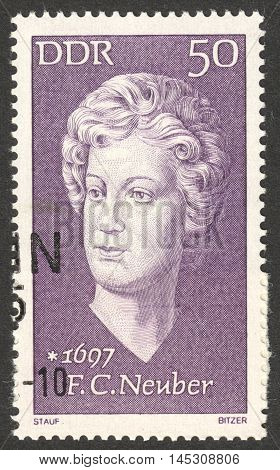 MOSCOW RUSSIA - CIRCA AUGUST 2016: a stamp printed in DDR shows a portrait of Friederike Caroline Neuber the series