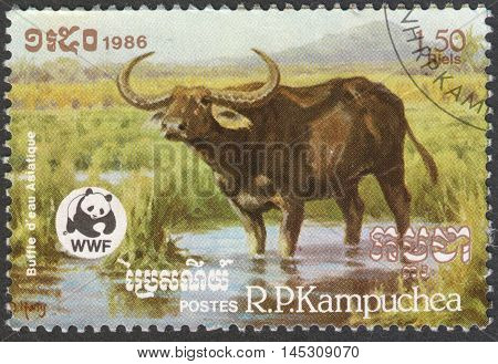 MOSCOW RUSSIA - CIRCA AUGUST 2016: a stamp printed in CAMBODIA shows an Asian Water Buffalo (Bubalus arnee bubalis) the series